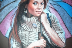 Noor naine vihmavarjuga,70x100 cm,pastell, paber2013
